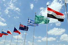 National Flags. Waving flags representing different countries with blue sky background Royalty Free Stock Image