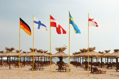 National flags. Five flags on the beach Stock Image