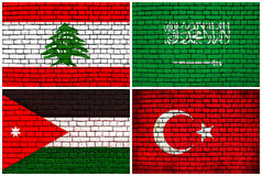National flags brick wall background Royalty Free Stock Photos