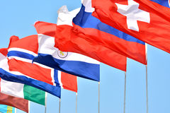 National flags of countries. Different countries national flags getting together under blue sky, shown as worldwide, country, and international communication or Stock Photography