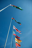 National flags of different countries. Against the sky Royalty Free Stock Photography