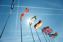 National flags of different countries. Against the sky Stock Photography