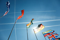 National flags of different countries. Against the sky Stock Images