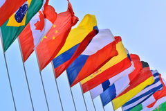 National flags of different countries. Different countries national flags getting together under blue sky, shown as worldwide, country, and international Stock Photography