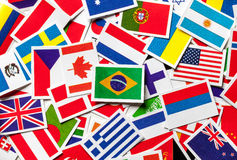 National flags of the different countries of the world in a scattered heap. Brazilian flag in the center. Stock Image
