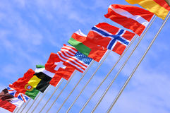 National flags of different country. Different countries national flags on pole as line, shown as world, country, and international communication or activities Stock Images