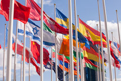 National flags of different country. Flags of the world happily blowing in the wind Stock Photo
