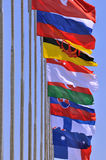 National flags of different country together. Different countries national flags on pole together, shown as worldwide, country, and international communication Royalty Free Stock Image