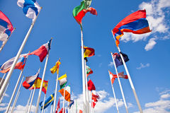 National flags of different country. Flags of the world happily blowing in the wind Stock Photos