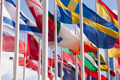 National flags of different country. Flags of the world happily blowing in the wind Royalty Free Stock Photography