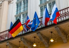 National flags of different world countries. National flags of world countries on the building facade. Flags of USA, Russia, Germany, European Union and Czech royalty free stock photo