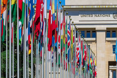 National flags at the entrance in UN office at Geneva, Switzerla Stock Photos