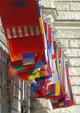 National flags flying in Vienna Austria. Flags representing many nations fly at the Wiener Kongresszentrum Hofburg BetriebsgesmbH Royalty Free Stock Images