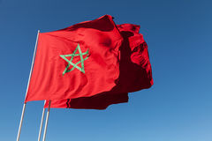 National flags of Morocco above blue sky Stock Photography