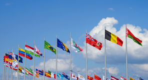 National flags. Row of national flags against blue sky Royalty Free Stock Images