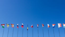 National flags. Row of national flags against blue sky Stock Photo