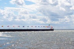 National flags of some world major global countries near the sea Stock Photos