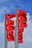 The national flags of Turkey against the blue sky royalty free stock photo