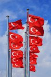 The national flags of Turkey against the blue sky royalty free stock photos
