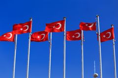 The national flags of Turkey against the blue sky stock image