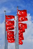 The national flags of Turkey against the blue sky stock photo