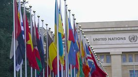 National flags of UN member countries flapping in front of Palace of Nations. Stock footage stock video