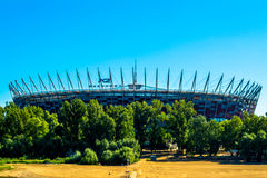 National football stadium of poland in Warsaw. Sunny summer day with a blue sky and green trees. Royalty Free Stock Photos