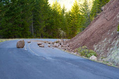 Landslide Blocked Road. This national forest road is blocked by a land slide of rock and debris to where it is a hazard for drivers in cars Stock Photos