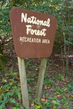 National Forest Sign. Brown national forest recreation area road sign, close-up Stock Photos