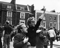 National Front March. An injured man is helped away after clashes between protesters and the National Front party, who were marching through Brixton, London Royalty Free Stock Image