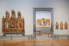 National Gallery empty rooms with artworks in London. LONDON - AUGUST 6: National Gallery empty rooms on August 6, 2015 in London, UK. The museum was founded in Royalty Free Stock Images