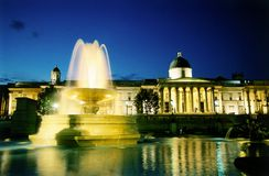 National gallery fountain. National gallery in Trafalgar square at dusk royalty free stock image