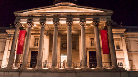 The National Gallery. London, UK - February 23, 2016: The National Gallery in London,in Trafalgar Square at dusk. The National Gallery houses one of the greatest stock photos