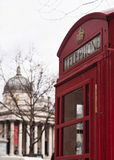 National gallery and red public phone. Traditional London symbol red public phone box and in the background the national gallery Stock Image