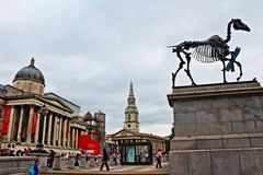 Trafalgar Square landmarks and artworks London England United Kingdom. The National Gallery,St Martin-in-the-Fields church and at the foreground contemporary Royalty Free Stock Photo