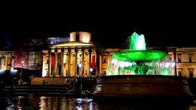 National Gallery and Trafalgar Square fountain at Night, London, England stock footage