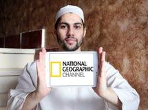 National geographic channel logo. Logo of national geographic channel on samsung tablet holded by arab muslim man Stock Photos