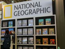 National geographic travel guidebooks on display in a book fair. Turin Italy May 9 2019 stock photography