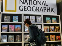 National geographic travel guidebooks on display in a book fair. Turin Italy May 9 2019 stock photo