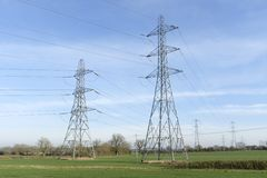 National Grid electricity pylons in UK. National Grid electricity pylons and overhead power lines cross countryside in rural Buckinghamshire, England, UK royalty free stock image