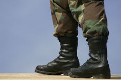 National Guard Boots. A member of the National Guard's feet in Boots standing on the roof of a new home under construction Royalty Free Stock Photography