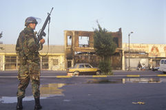 National Guardsman patrolling in front of burned business after 1992 riots, South Central Los Angeles, California Stock Photos