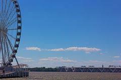 National Harbor Ferris wheel and Woodrow Wilson Memorial Bridge. Royalty Free Stock Photo