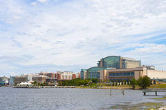 National Harbor waterfront buildings under the cloudy skies. Stock Photography