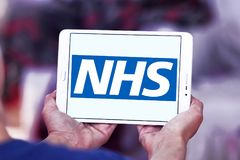 National Health Service , NHS , logo. Logo of National Health Service , NHS , on samsung tablet. The National Health Service NHS is the publicly funded national Royalty Free Stock Photos