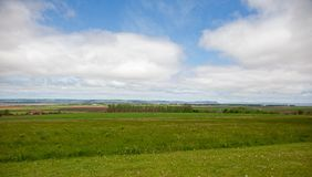 Blomidon and Grand Pre. A National Historic Site, the steeple of the Grand Pre Church is just visible in the middle of a meadow, with Cape Blomidon in the stock photo