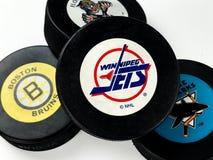 Hockey Pucks. National Hockey League vintage pucks with old team logos Stock Photo