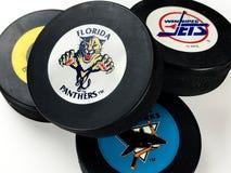 Hockey Pucks. National Hockey League vintage pucks with old team logos Royalty Free Stock Photo