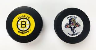 NHL Hockey Pucks. National Hockey League vintage pucks with old team logos Stock Photo