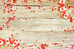 The national holiday of July 1- happy Canada day , Dominion day, the concept of patriotism, independence and memory, a place for. Text. white red confetti and royalty free stock photo